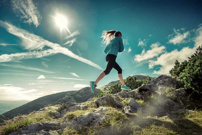 woman running in the hills
