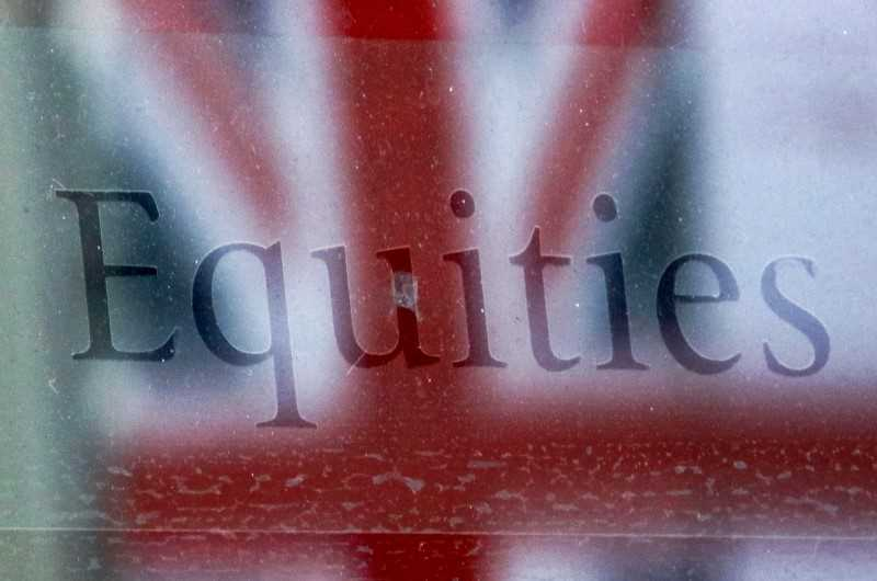 The word Equities is written on a window behind which we can see the Union Jack
