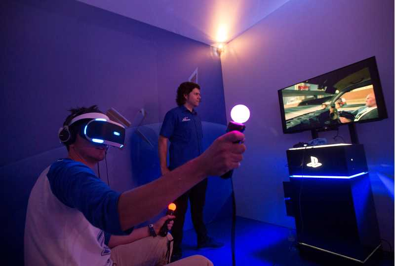 Photo of a person using Sony's VR glasses and PlayStation.